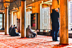 Men praying in Sultan Ahmed Mosque or Blue Mosque in Istanbul Stock Image
