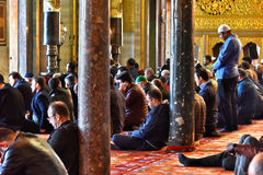Men praying in Sultan Ahmed Mosque or Blue Mosque in Istanbul Royalty Free Stock Photography