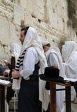 Men Praying in the Western wall. Men wearing shawls praying in the Western wall Stock Photo