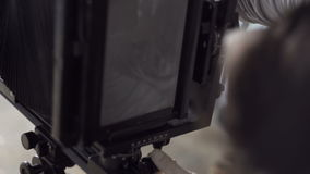 Men prepare the camera to shoot close-up stock video