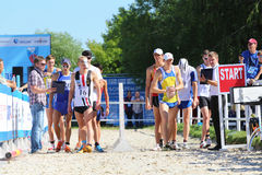 Men prepare for race in competitions Stock Image