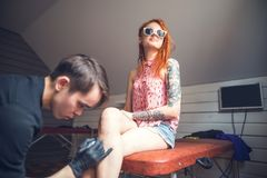 Tattoo and art. The men prepared to draw tattoo designs on the foot girls. tattoo and art stock photo