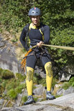 Men prepering for descending. Waterfall in rappel Stock Photo
