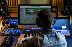 Men produce electronic music. In project home studio Stock Photo