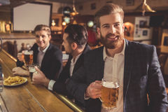 Men at the pub Stock Images