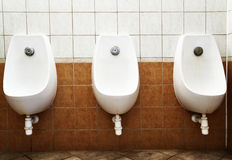 Men public toilet. With urinals on the wall Royalty Free Stock Photo