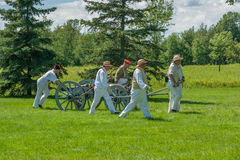 Men Pulling Cart and Canon Royalty Free Stock Photos
