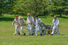 Men Pulling Wagon with Canon Stock Photos