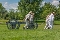 Men Pulling Wagon and Canon Royalty Free Stock Image