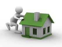 Men push house on white background. Isolated 3D image Royalty Free Stock Photo