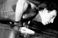 Men push-up. And look ahead / Black and White Stock Photo