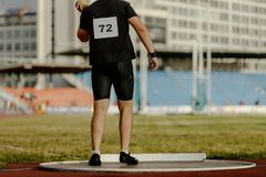 Men pusher preparing shot put. At track and field competition Stock Photo