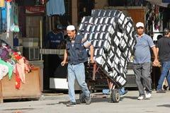 Men pushing a trolley Royalty Free Stock Image