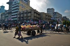 Men pushing wagon of bags in Dhaka Royalty Free Stock Photos