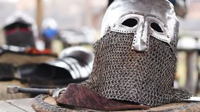 Men putting on medieval knights' armour, preparing for reenactment of battle. Stock footage stock video footage