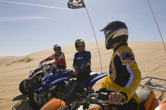Men On Quadbikes In Desert Stock Image