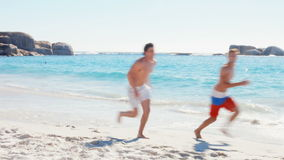 Men racing on the beach. In ultra hd format stock footage