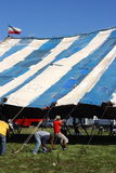Men Raising Circus Tent. Employees of the Culpepper and Merriweather Circus raise the circus tent by hand in preparation for an afternoon show. Culpepper and Stock Photography