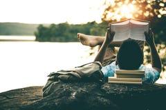 Men read books in quiet nature. stock images