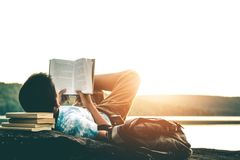 Men read books in quiet nature. royalty free stock photo