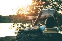Men read books in quiet nature. stock photography