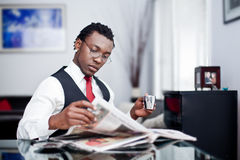 Men reading the news paper. Men sitting reading the news paper at home Royalty Free Stock Image