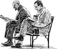 Men reading Royalty Free Stock Photo