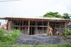 Men reconstructing their house. Two men are reconstructing their house after an hurricane destroyed it Royalty Free Stock Photo