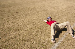 Men in Red Shirt Lying on a Brown Ground during Daytime Stock Photos