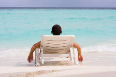 Men relaxing on abeach. Men relaxing at a tropical beach Stock Images
