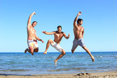 Men Relaxing On the Beach Stock Images