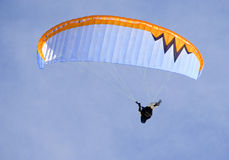 Men relaxing paragliding. On a beautiful winter sunny day Royalty Free Stock Images