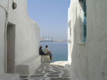 Men relaxing at seaside house, Mykonos, Greece Royalty Free Stock Photography