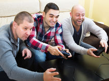 Men relaxing with video game Stock Photos