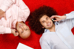 Men relaxing at work Stock Photos