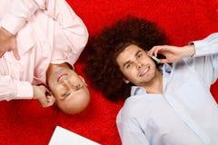Men relaxing at work Stock Photos