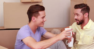 Men during a relocation drinking in a cup stock video