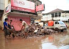 Men removing trash after floods Stock Photo