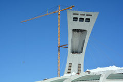 Men repair the Montreal Olympic Stadium tower Royalty Free Stock Photography