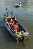 Men repairing engine in fishingboat Havana Royalty Free Stock Images