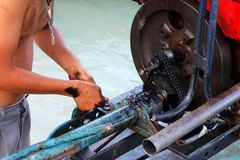 Men are repairing engines adapted for long-tail boats. Royalty Free Stock Photography