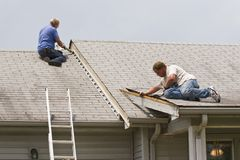 Men repairing house stock photography