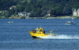 Men into rescue boat on the lake in Neuchatel, Stock Photography