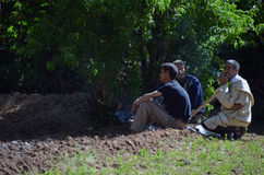 Men resting after a long day at work Royalty Free Stock Photography