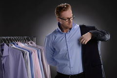 Men in retail store. Confident young businessmen wearing suit in Royalty Free Stock Image