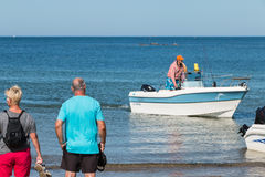 Men returning from a sea fishing competition Royalty Free Stock Photography