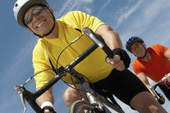 Men Riding Bicycles Against Sky Royalty Free Stock Images