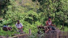 Men are riding on elephants. Myanmar, Yangon. 09.11.2013  Men are riding on elephants through the jungle. Trained rideable elephants stock footage