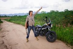 Men riding a motorcycle. In the countryside Royalty Free Stock Image