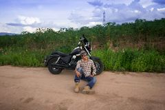 Men riding a motorcycle. In the countryside Royalty Free Stock Photos